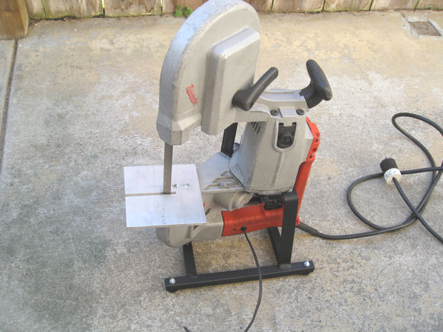 Portable bandsaw stand for 12 inch portable table saw