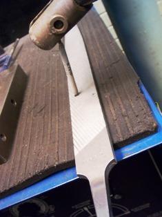7018 welding rod being filed before restart
